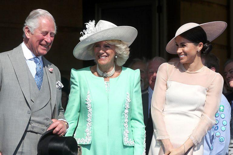Carlos, Camilla y Meghan