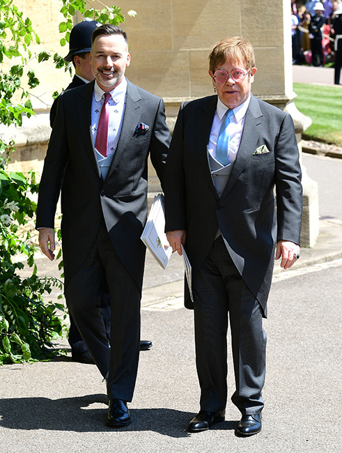Sir Elton John y David Furnish en la boda de Harry y Meghan